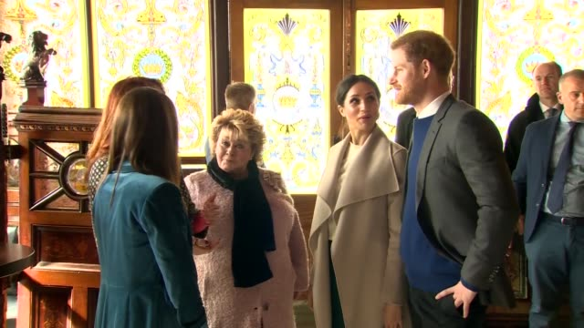 prince harry and meghan markle visit crown liquor saloon in belfast int prince harry and meghan markle chatting with people in liquor saloon - crown headwear stock videos and b-roll footage