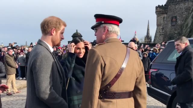 Prince Harry and Meghan Markle visit the top of Edinburgh Castle for the one o'clock gun rota on their first trip to Scotland together