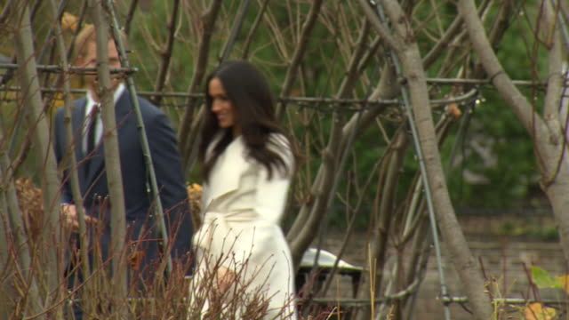 Prince Harry and Meghan Markle walking through the Sunken Garden at Kensington Palace as they prepare to announce their engagement