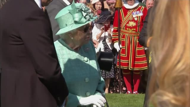 Continuing doubt over the attendance of her father Thomas Markle ENGLAND London Buckingham Palace EXT Various of Queen Elizabeth II meeting people at...