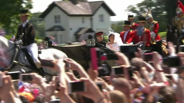 prince harry and meghan markle wedding day windsor crowds high angle back view of horse drawn carriage carrying prince harry duke of sussex and... - meghan duchess of sussex stock videos and b-roll footage