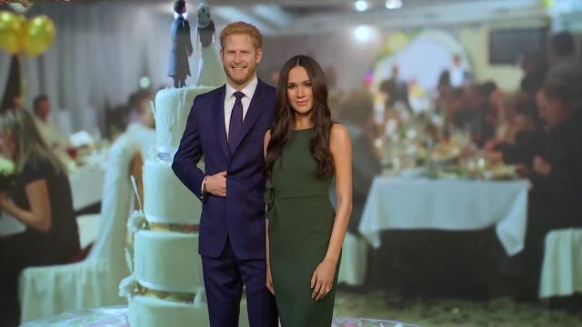 meghan markle waxwork unveiled at madame tussauds england london madame tussauds int reporter standing alongside waxworks of meghan markle and prince... - madame tussauds stock videos & royalty-free footage