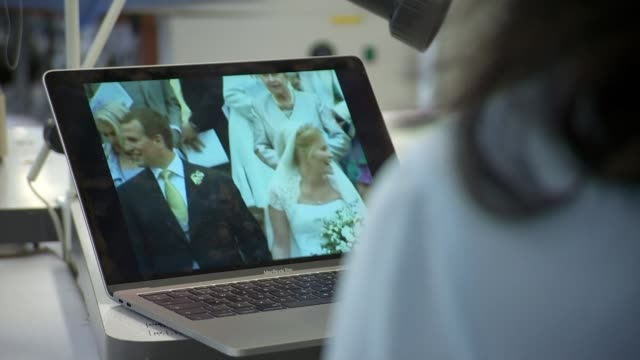 Previous royal wedding dresses ITN POOL Sources inseparable INT **Holford interview partly overlaid SOT** Laptop computer playing footage of Peter...