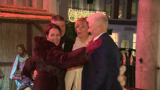 prince harry and meghan markle wedding to take place on same day as fa cup final; berkshire: windsor: night rod and collette hugging guests outside... - guest stock videos & royalty-free footage