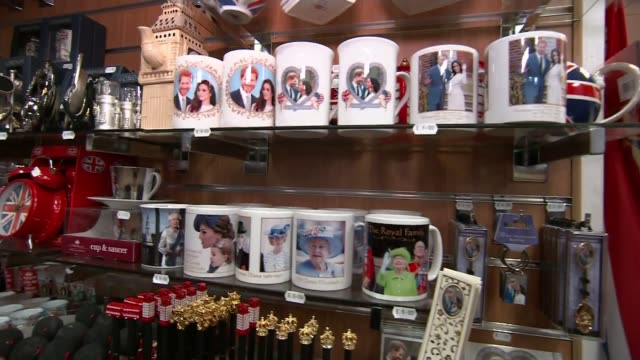 Prince Harry and Meghan Markle wedding to take place on same day as FA Cup Final Berkshire Windsor INT Items for sale on shelves inside gift shop...