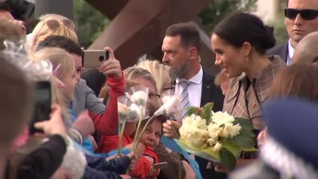 Prince Harry and Meghan the Duke and Duchess of Sussex greet crowds at the Pukeahu National War Memorial in Wellington during the Royal Tour to New...