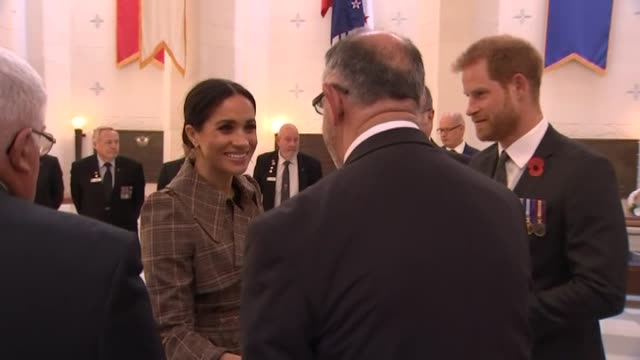 Prince Harry and Meghan the Duke and Duchess of Sussex greet dignitaries inside the Pukeahu National War Memorial in Wellington during the Royal Tour...
