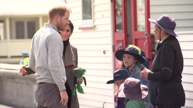 prince harry and meghan the duke and duchess of sussex meet school children outside maranui cafe in lyall bay wellington on day two of their royal... - wellington new zealand stock videos and b-roll footage