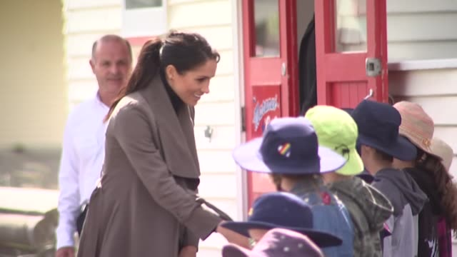 prince harry and meghan the duke and duchess of sussex meet school children outside maranui cafe in lyall bay wellington on day two of their royal... - harry meghan tour stock videos and b-roll footage