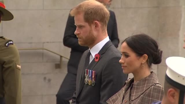 Prince Harry and Meghan the Duke and Duchess of Sussex observe a moment of silence at the Pukeahu National War Memorial in Wellington during the...