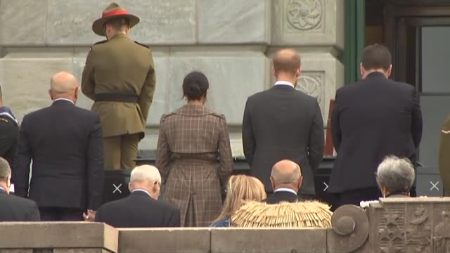 Prince Harry and Meghan the Duke and Duchess of Sussex pay their respects during visit to the Pukeahu National War Memorial in Wellington on day one...