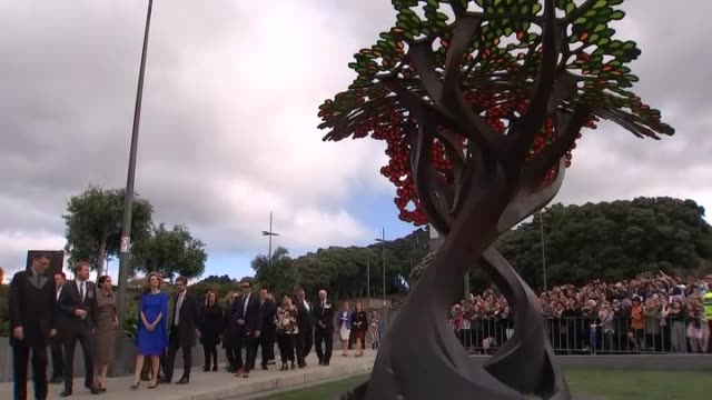 Prince Harry and Meghan the Duke and Duchess of Sussex take in the British war memorial tree at Pukeahu National War Memorial in Wellington during...
