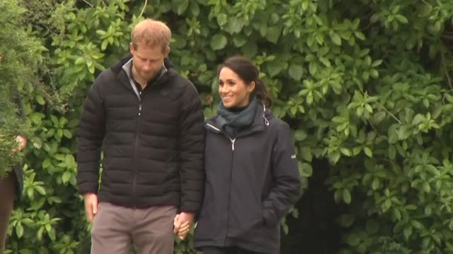 Prince Harry and Meghan the Duke and Duchess of Sussex walk hand in hand during visit to Abel Tasman National Park on day two of their Royal Tour to...