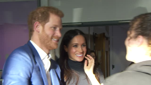 Prince Harry and new fiancee Meghan Markle greeting members of the Nottingham Academy