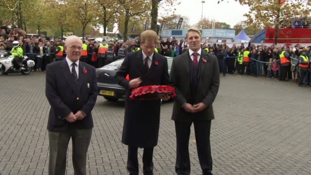 prince harry arrives at twickenham england london twickenham ext prince harry out of car and given poppy wreath / prince harry and others stand to... - music stand stock videos & royalty-free footage