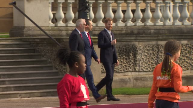 prince harry arrives for first official engagement since the announcement he is stepping down as a senior royal watching local schoolchildren play... - formal garden stock videos & royalty-free footage