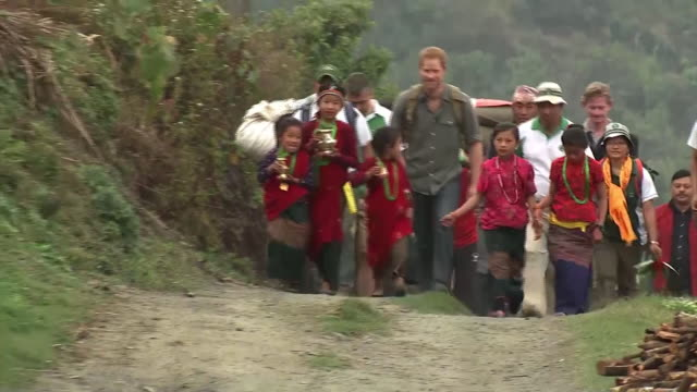 prince harry arriving in the himalayan village of leorani on his visit to nepal - nepal stock-videos und b-roll-filmmaterial