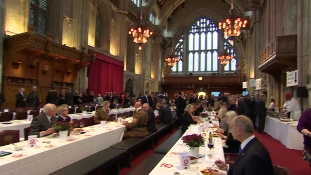 Prince Harry at Big Curry Lunch Reception Prince Harry chats with war veterans and soldiers / People eating and drinking / People serving curry / Man...