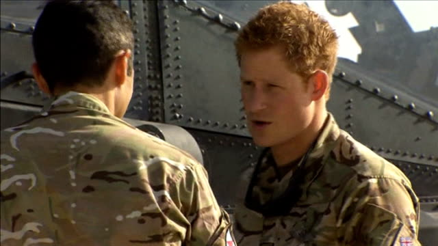 prince harry at camp bastion during taliban attack 792012 helmand camp bastion various of prince harry inspecting british army apache helicopter with... - attack helicopter stock videos and b-roll footage