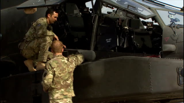 prince harry at camp bastion during taliban attack 792012 various of prince harry inspecting british army apache helicopter with colleague - attack helicopter stock videos and b-roll footage