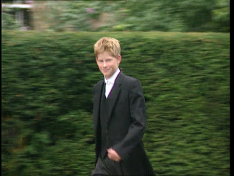 SUE SAVILLE ENGLAND Berks Eton i/c Prince Harry in Eton school uniform of waistcoat and tails along smiling Prince Harry and others along Master...