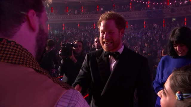 Prince Harry at the Royal Variety Show Jack Whitehall on stage near The Corrs and Elton John / Prince Harry chats with The Corrs Beverley Knight...