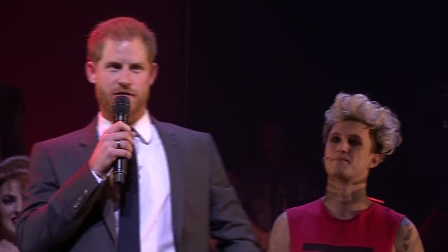 prince harry attends gala performance of 'bat out of hell'; england: london: dominion theatre: int prince harry, duke of sussex onto stage at a gala... - ウェストエンド点の映像素材/bロール