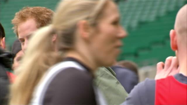 vídeos de stock, filmes e b-roll de prince harry attends london marathon training session at twickenham england london twickenham stadium ext prince harry with others along through... - tunnel