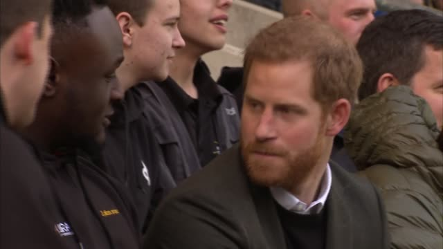 Prince Harry attends open training session at Twickenham EXT Crowd seated in stands / Prince Harry arriving on pitch with Jonny Wilkinson and taking...