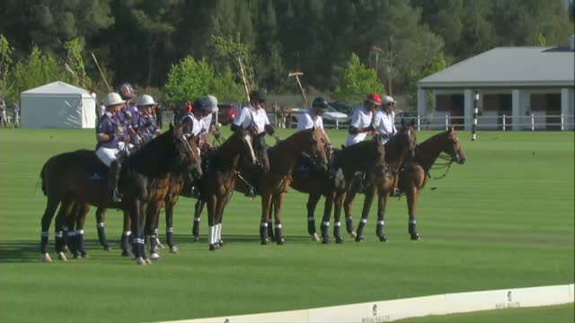 Prince Harry attends polo match for his Sentebale charity Shows exterior shots Prince Harry on horseback before polo match lining up with teammates...