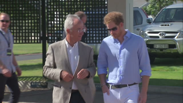 Prince Harry attends polo match for his Sentebale charity Shows exterior shots Prince Harry arriving for charity polo match walking with Philip Green...