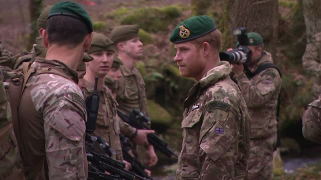 prince harry attends royal marines passing out ceremony; england: devon: bickleigh: 42 commando royal marines: ext royal marines commando recruits... - military recruit stock videos & royalty-free footage