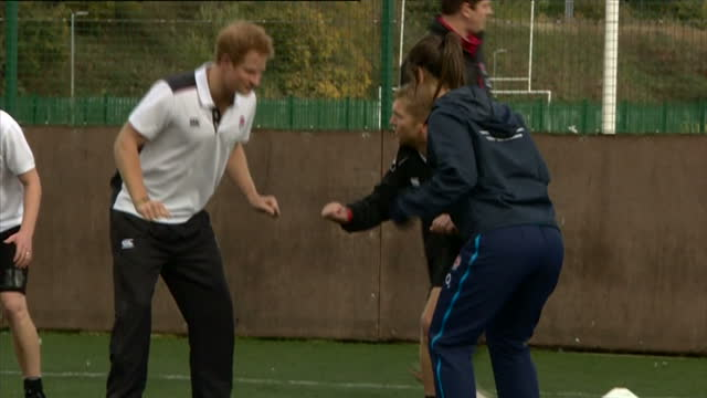 prince harry attends rugby festival at eccles rfc shows exterior shots prince harry warming up with players on training pitch on october 20 2014 in... - jugendmannschaft stock-videos und b-roll-filmmaterial