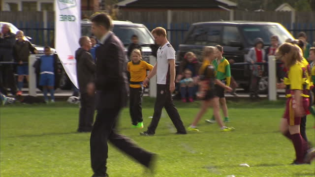 prince harry attends rugby festival at eccles rfc shows exterior shots prince harry watching youngsters warming up before rugby match passing the... - jugendmannschaft stock-videos und b-roll-filmmaterial
