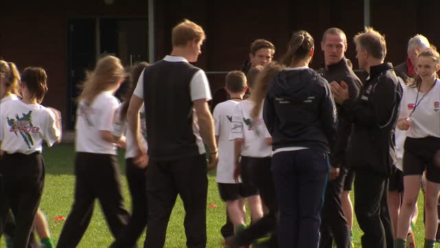 prince harry attends rugby festival at eccles rfc shows exterior shots prince harry talking to girls team on pitch before match on october 20 2014 in... - jugendmannschaft stock-videos und b-roll-filmmaterial