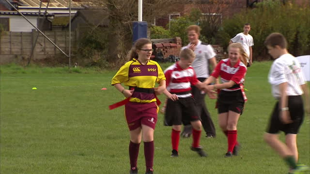 prince harry attends rugby festival at eccles rfc shows exterior shots prince harry watching youngsters playing rugby on october 20 2014 in salford... - jugendmannschaft stock-videos und b-roll-filmmaterial