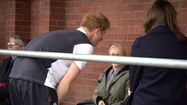prince harry attends rugby festival at eccles rfc shows prince harry walking with trainers at event and talking to people watching their children on... - jugendmannschaft stock-videos und b-roll-filmmaterial