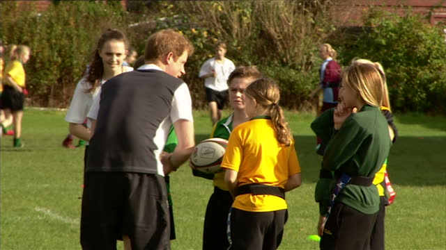 prince harry attends rugby festival at eccles rfc shows prince harry talking to young rugby players during match on october 20 2014 in salford england - jugendmannschaft stock-videos und b-roll-filmmaterial