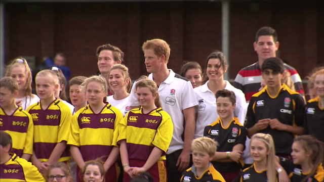 prince harry attends rugby festival at eccles rfc shows prince harry standing in photo opportunity team photo with rugby players on october 20 2014... - jugendmannschaft stock-videos und b-roll-filmmaterial
