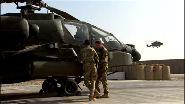 prince harry begins second deployment in afghanistan afghanistan camp bastion various of prince harry inspecting british army apache helicopter with... - apache helicopter stock videos and b-roll footage