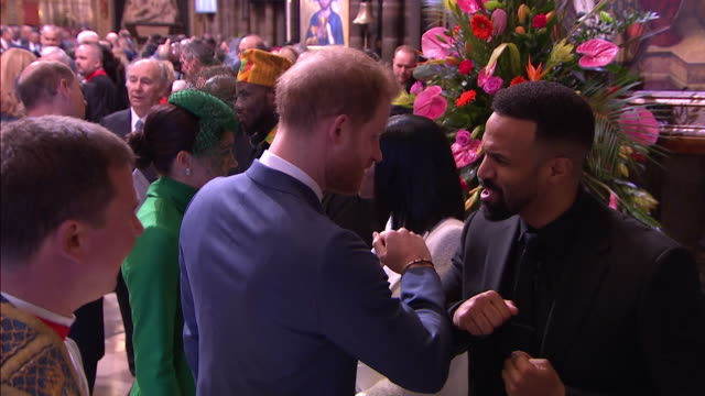 prince harry bumps elbows with craig david, avoiding handshake due to coronavirus, after commonwealth day service in westminster abbey - 肘点の映像素材/bロール