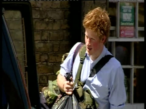 prince harry carries black bin bag amongst other luggage to car having finished education at eton college berkshire 12 jun 03 - bin bag stock videos & royalty-free footage