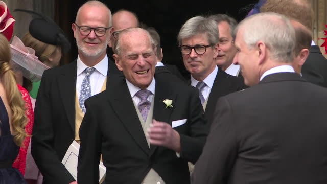 prince harry chats with prince philip outside st george's chapel after the wedding of lady gabriella windsor to thomas kingston filmed from two angles - prince philip stock videos & royalty-free footage