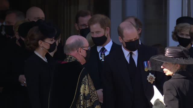 prince harry chatting with his sister in law, the duchess of cambridge, as the leave st george's chapel after the funeral of prince philip, the duke... - place of worship stock videos & royalty-free footage
