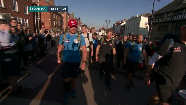 prince harry commits to helping combat veterans; england: shropshire: ext logo on screen reporter to camera with prince harry and veterans walking in... - rucksack stock videos & royalty-free footage