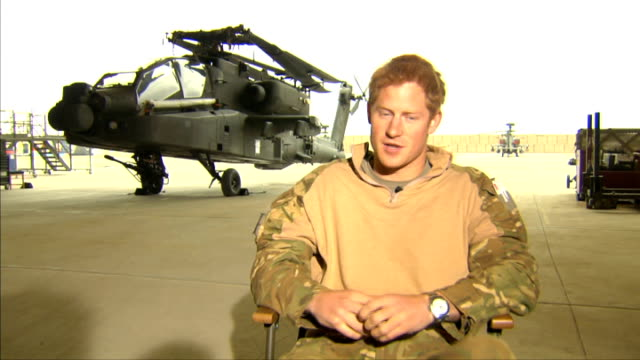 prince harry criticises media coverage of his private life; afghanistan: camp bastion: int **harry interview partly overlaid sot** prince harry ext... - anger stock videos & royalty-free footage