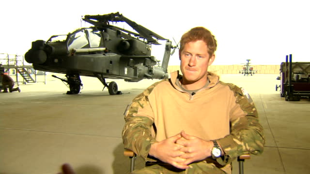 Prince Harry criticises media coverage of his private life Recent Camp Bastion EXT Prince Harry walking with colleagues at base Harry in helicopter...