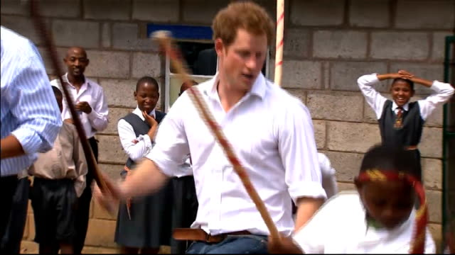 prince harry dances with children during visit to kananelo centre for the deaf lesotho kananelo centre for the deaf ext prince harry and group of... - prinz harry stock-videos und b-roll-filmmaterial