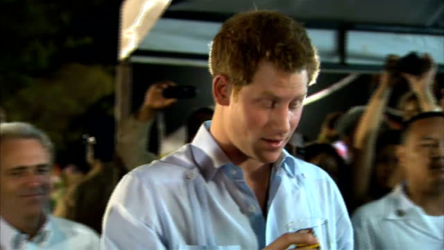 prince harry diamond jubilee tour of caribbean and brazil harry dances in belize ****flash prince harry drinking a glass of local rum prince harry... - beer alcohol stock videos and b-roll footage