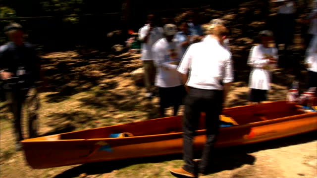prince harry diamond jubilee tour of caribbean and brazil harry arrives in the bahamas 332012 prince harry pouring beer over canoe to launch it close... - itv weekend lunchtime news点の映像素材/bロール